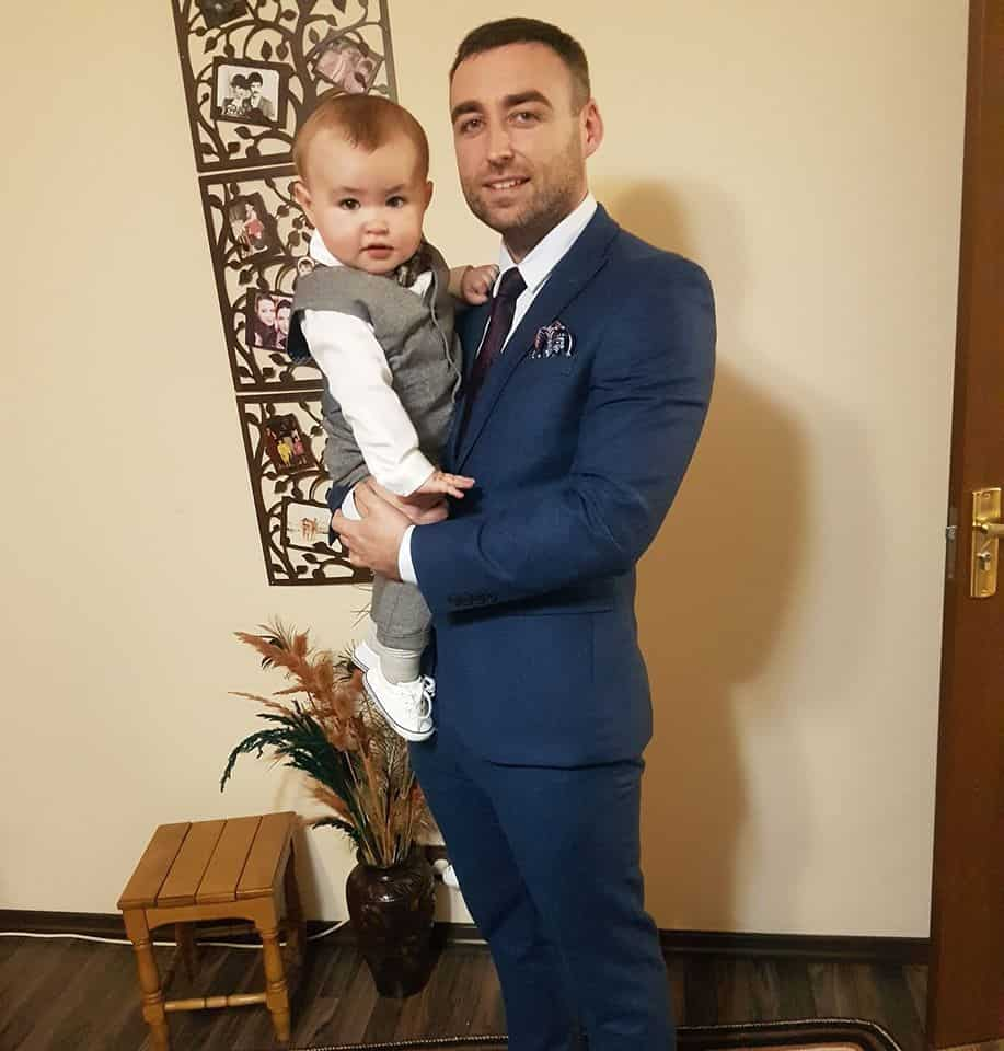 James Cosgrove standing and holding James Jnr his young son