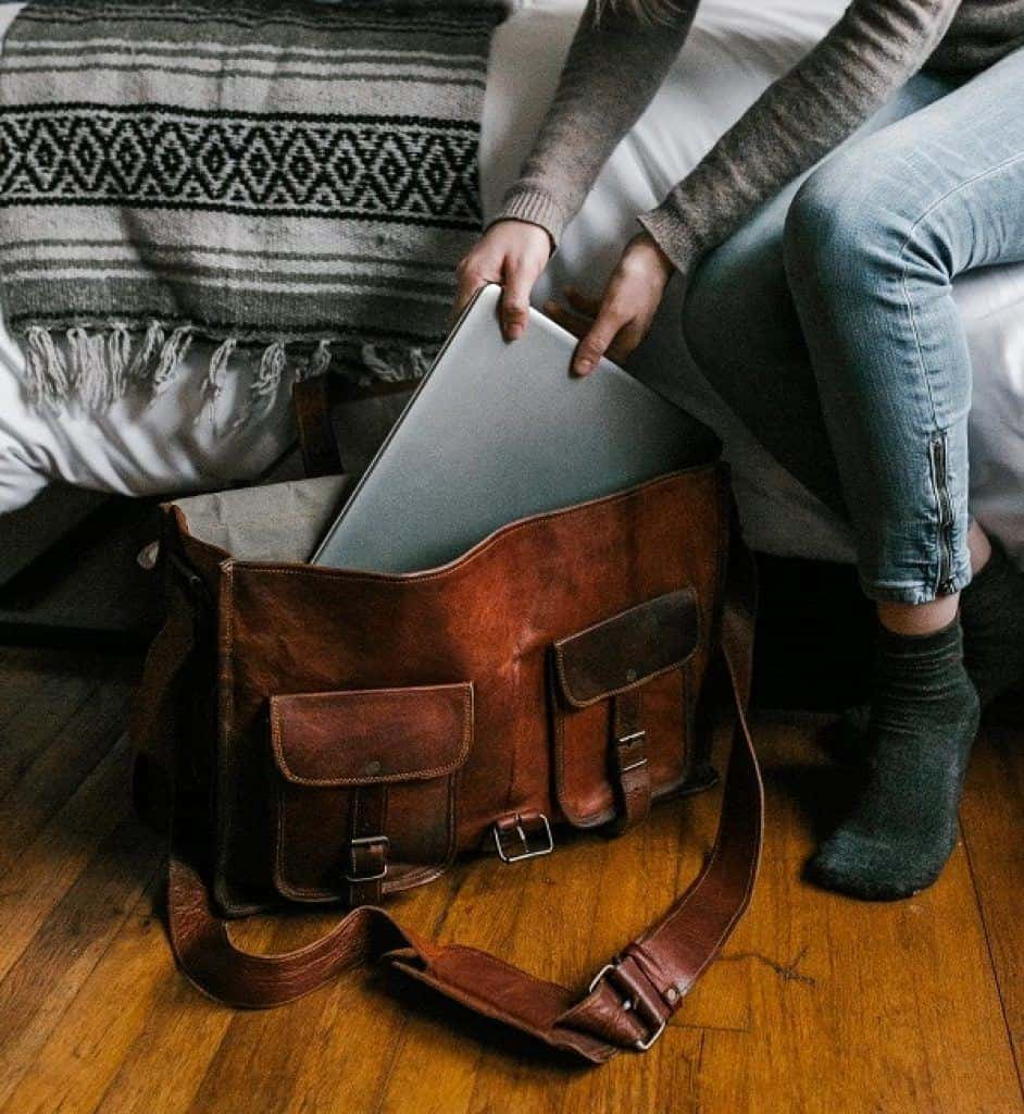 packing laptop in leather laptop bag