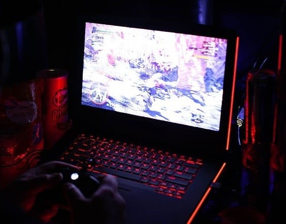 a gamer gaming on his laptop