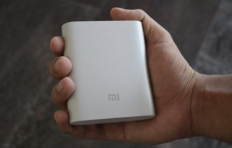 a power bank in a man's hand