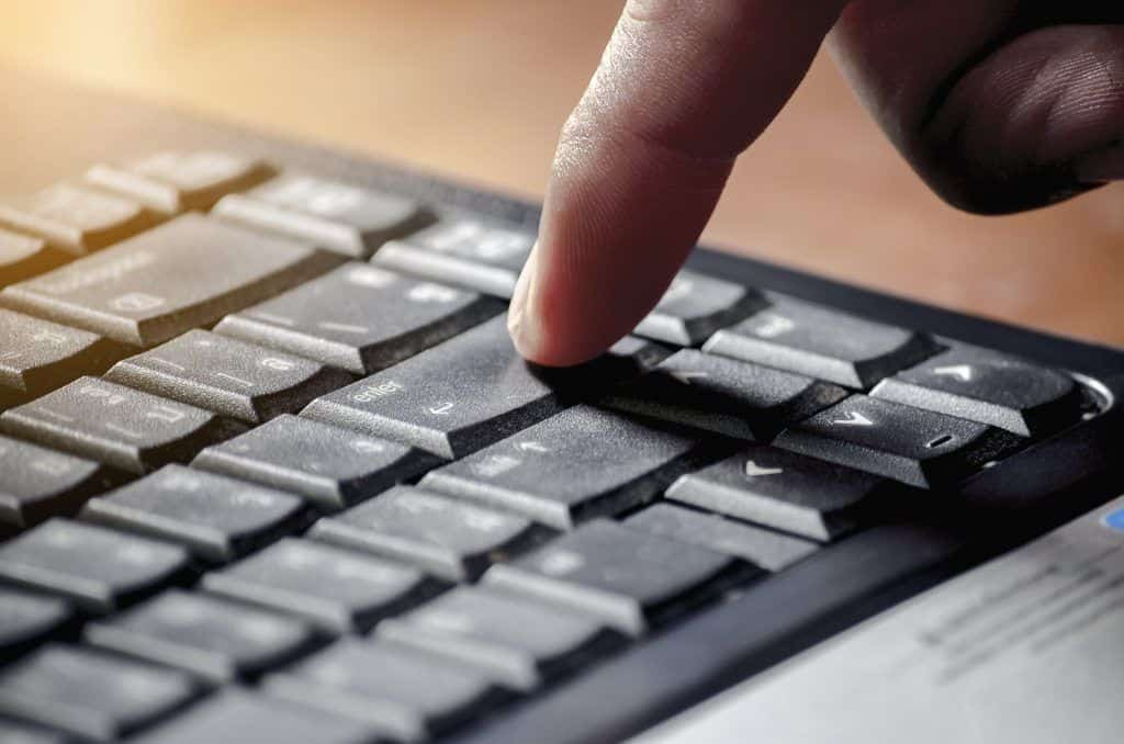 A person using the fingerprint feature of Lenovo ThinkPad X1 Carbon Gen 8